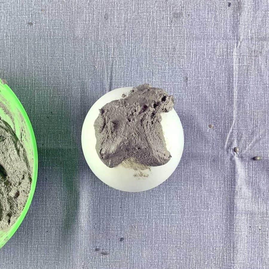 cement mix piled onto balloon