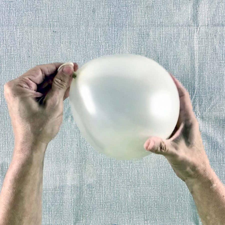 holding balloon sideways