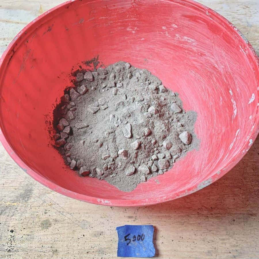bowl with dry concrete mix with large grocks