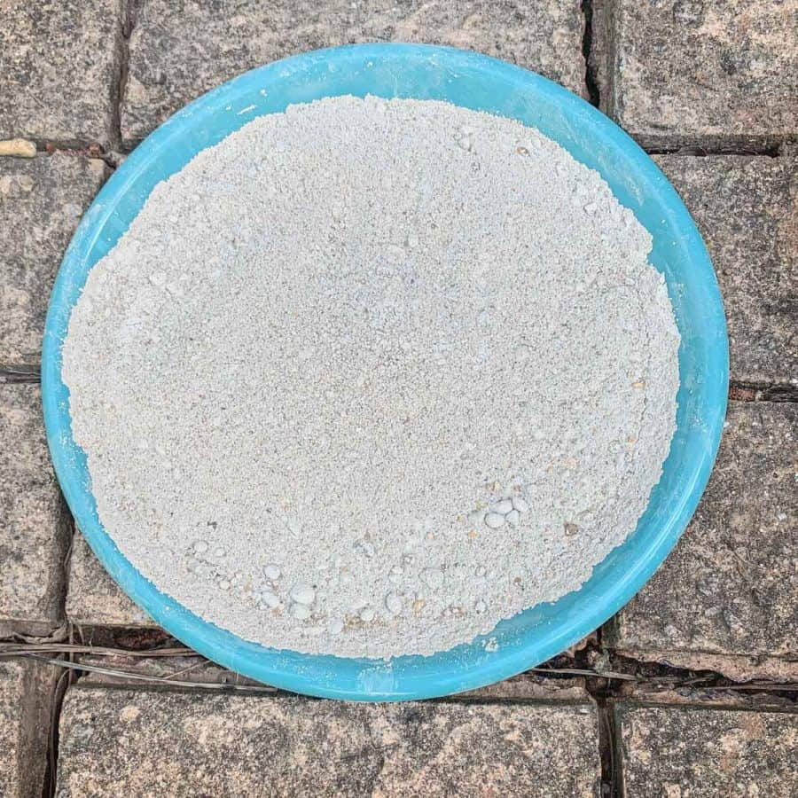 mortar mix on plate has fine cement with very small round gravel in it it