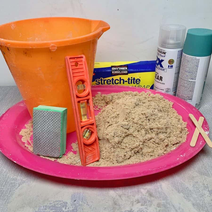 materials for making a diy concrete butterfly puddler.