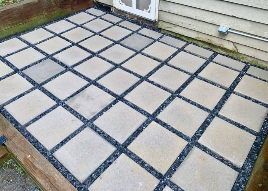 finished concrete paver patio with pavers lined up in rows