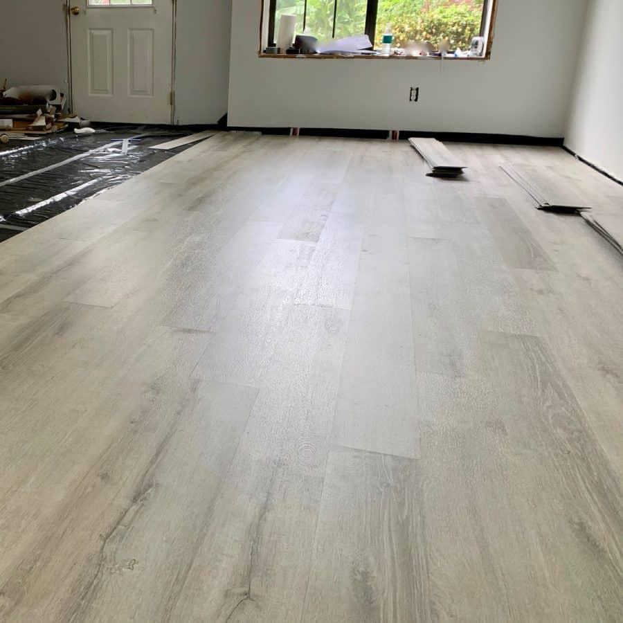 level concrete floor- floor with vinyl planks installed across half of room