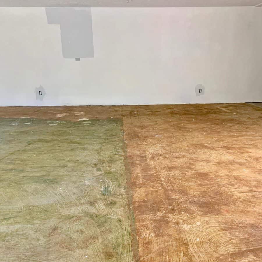 level concrete floor- floor covered with dark marks of carpet glue