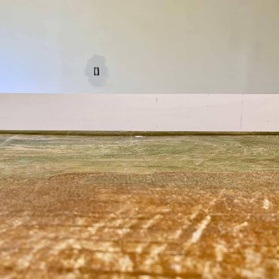 level concrete floor- 1x4 board on floor showing large gap underneath