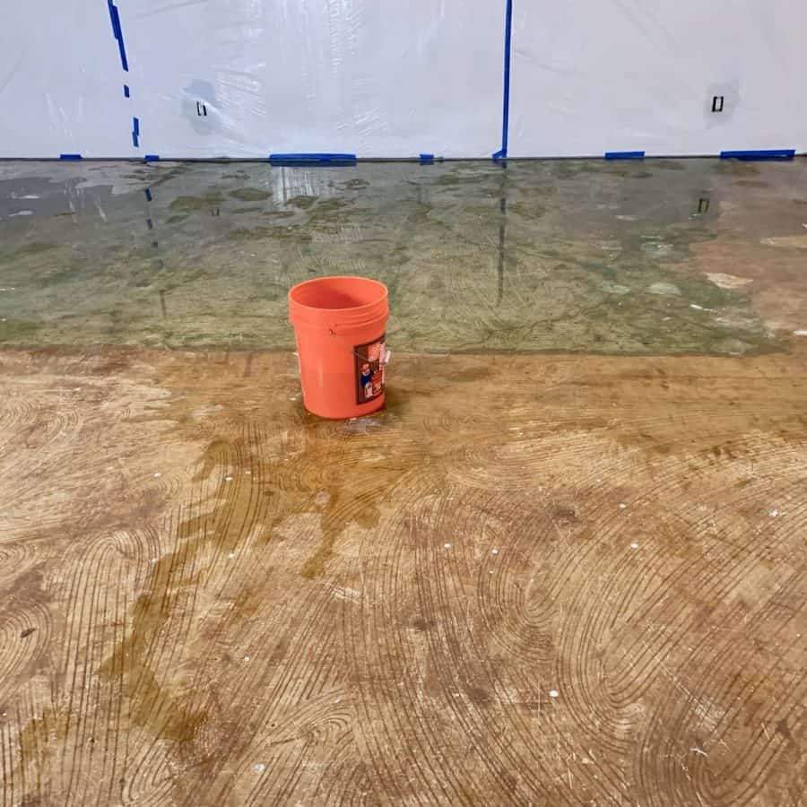 level concrete floor- floor covered with water and bucket on top