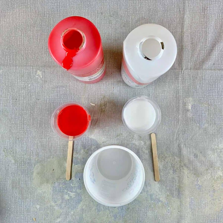 Silicone Sphere Mold- mold materials a & b poured into cups with mixing straws and larger cup