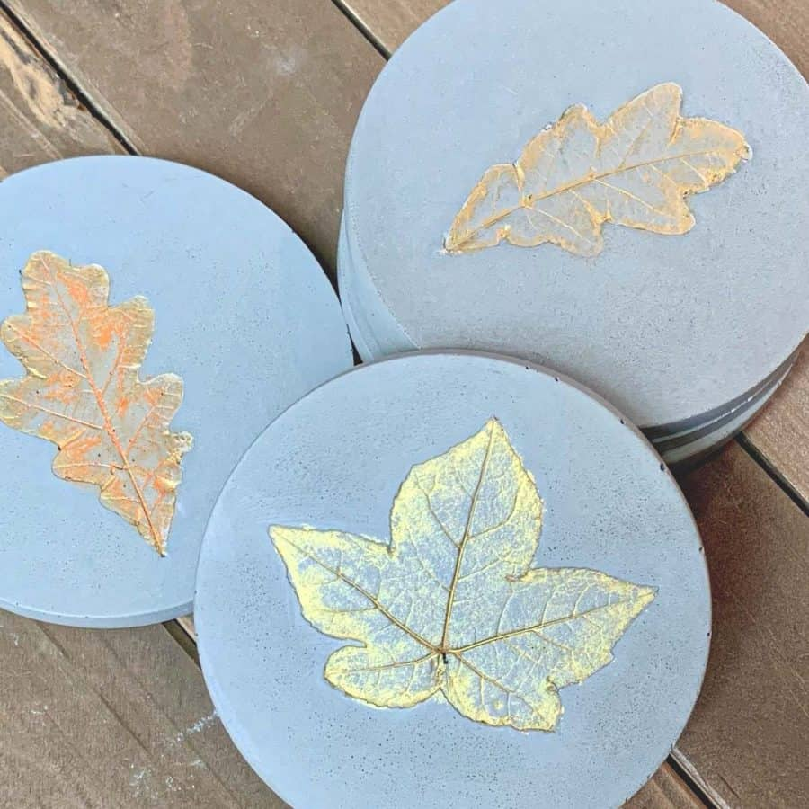 Concrete Coasters-3 concrete coasters with leaf imprints, painted in iridescent gold and orange colors.