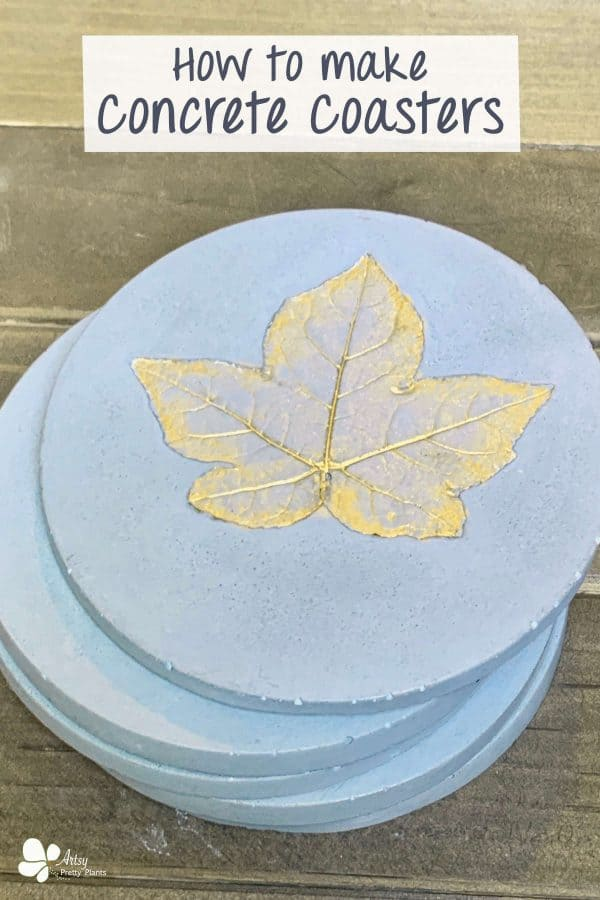 Concrete Coasters- stack of handmade coasters with top leaf painted shimmery gold.