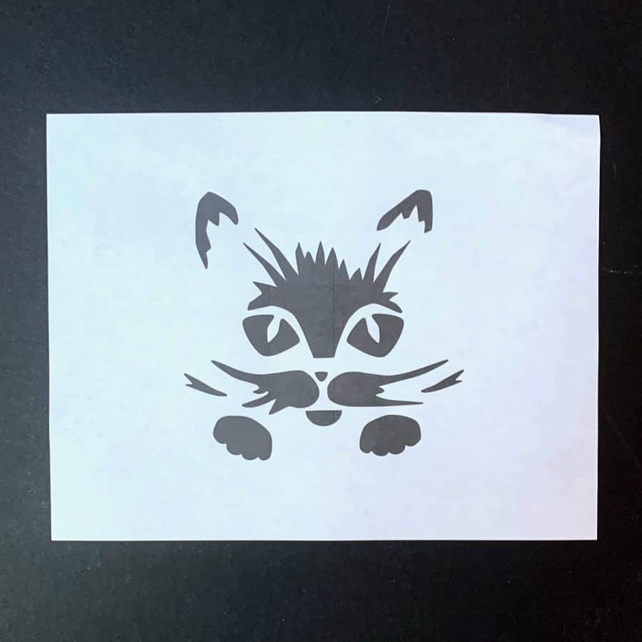 paper printout of black and white cat face jack o lantern carving pattern