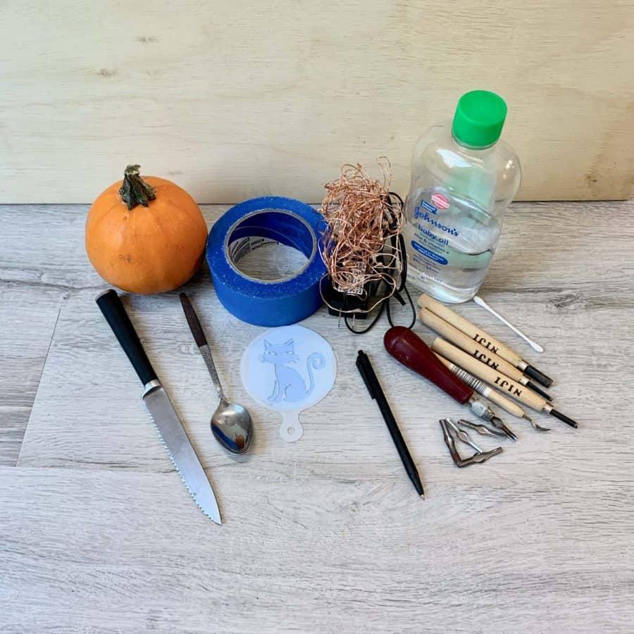tools for carving a mini pumpkin of a cat