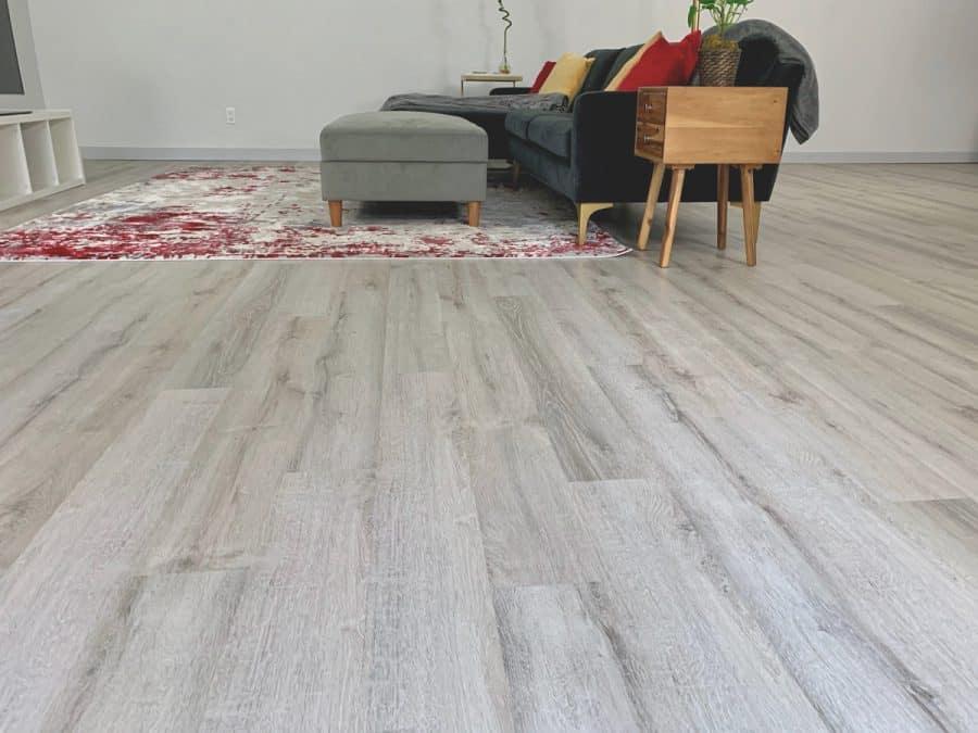 modern finished living room on level floor with luxury vinyl plank flooring