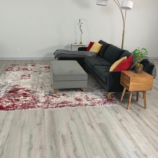 modern living room with leveled concrete floor underneath vinyl plant flooring
