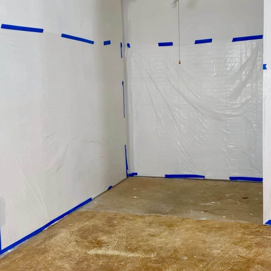 walls taped with plastic drop cloth