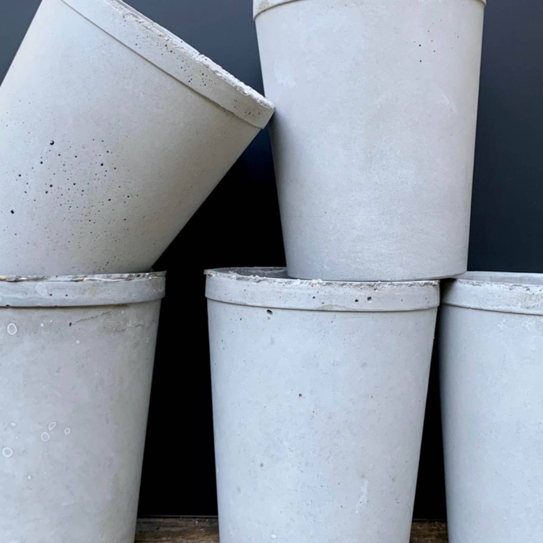 5 concrete vessels made with 5 different mixing ratios of portland cement to sand and gravel